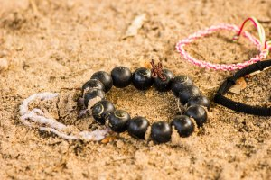 Bracelets left on mass graves to honour the dead