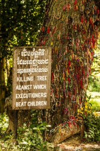 """Killing tree against which executioners beat children"". Covered in bracelets and flowers."