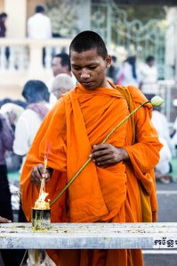 Monk lighting incense.