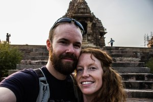 Sexy couple in front of a sexy temple