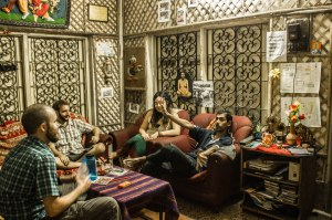 Chillin' and chatting in the living room at the hostel, listening to Rupak's stories.