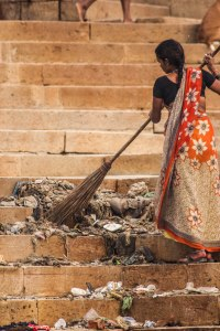 Sweeping the ghat.