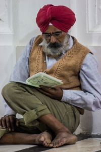 Reading prayers in a corner.