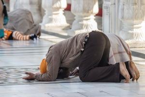 Praying.